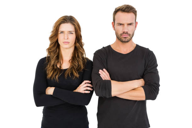 Upset couple standing with arms crossed - foto stock