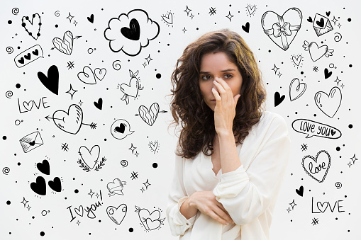 istock Upset curly brunette wiping tears away 1207640845