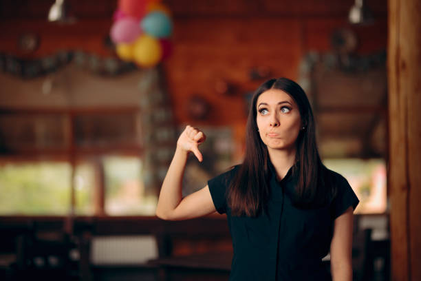 Upset Customer Showing Thumbs Down In a Restaurant Unsatisfied client reviewing failing business critic stock pictures, royalty-free photos & images