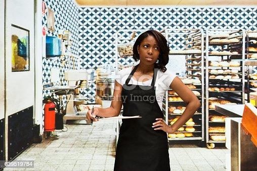 545282128 istock photo Upset female baker standing in bakery 639519784