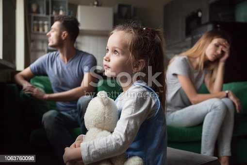 istock Upset, frustrated little girl tired of parents fight 1063760098