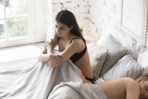 upset girlfriend thinking about relationship problems and lover indifference - sex and reproduction stock pictures, royalty-free photos & images