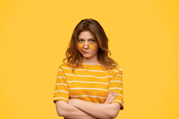 Upset hipster with crossed arms stock photo