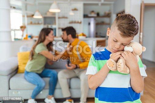 1166996783 istock photo Upset little child boy holding toy. 1227162885