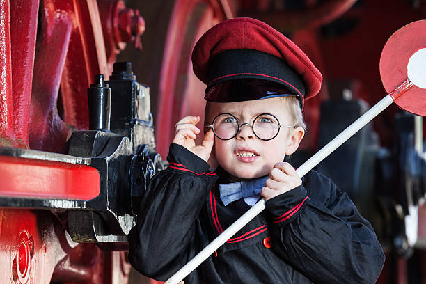 upset little railroad conductor - transport conductor stock photos and pictures