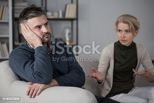 istock Upset man and complaining wife 916332958