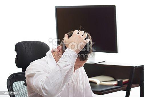 932342408istockphoto Upset man in office background 946972328