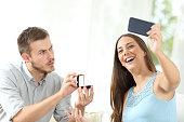 istock Upset man proposing marriage and girlfriend taking selfie 1182919121