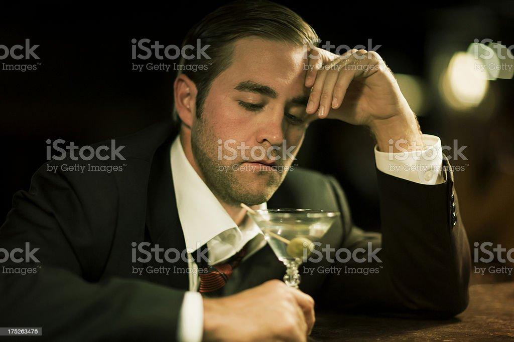 Upset Man With Martini Glass At Bar. stock photo