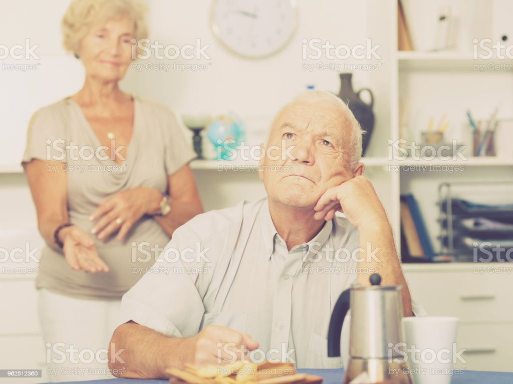 Upset mature man after discord with woman - Royalty-free 60-64 Years Stock Photo