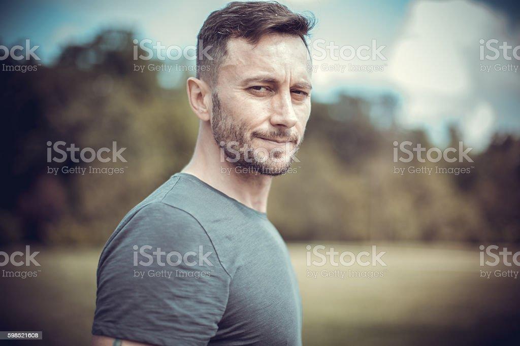 sad middle aged man walking alone