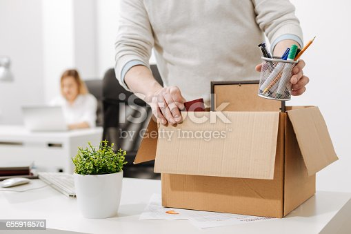 1048789678istockphoto Upset office manager packing the box and leaving the office 655916570