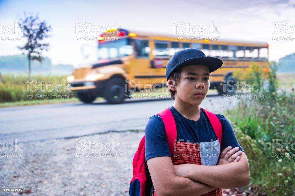 Upset preteen boy not wanting to go to school stock photo