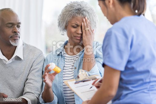 istock Upset senior woman talks with docotr 1055095222