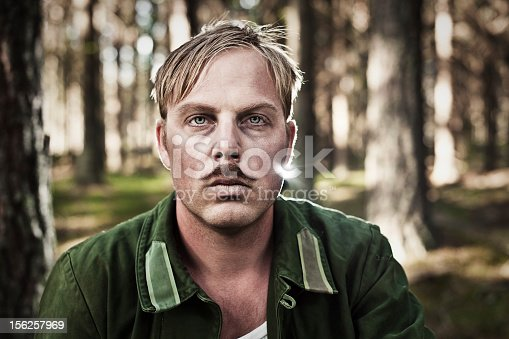 upset soldier in the woods