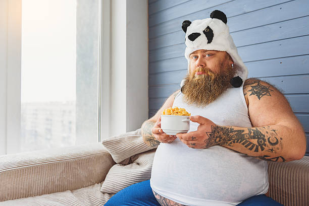 Upset thick guy is on a diet stock photo