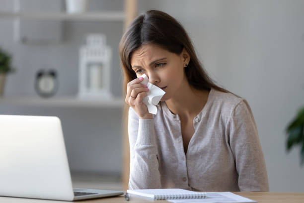 Upset woman crying, looking at laptop screen, watching sad movie Upset woman crying, looking at laptop screen, watching sad movie or reading bad news, unhappy girl holding handkerchief in hand, wipes away tears, sitting at desk, using computer sentimentality stock pictures, royalty-free photos & images