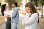istock Upset woman crying, seeing her boyfriend with other girl 1178133993