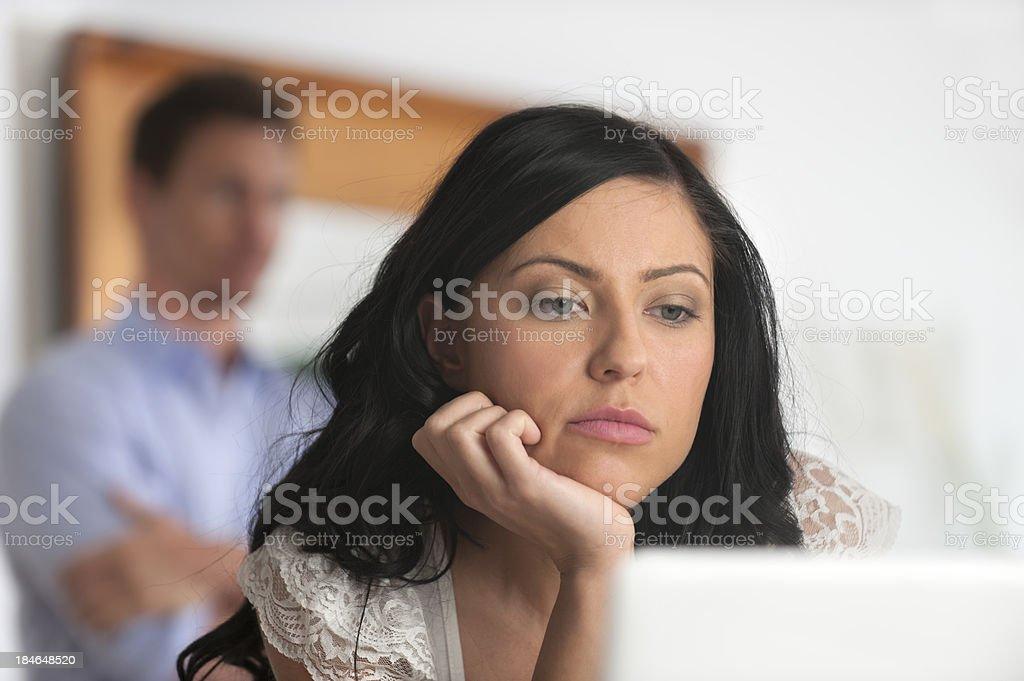 Upset woman looking at a computer screen stock photo