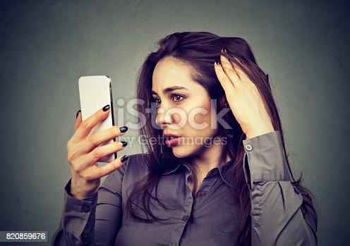 istock upset woman surprised she is losing hair has receding hairline 820859676
