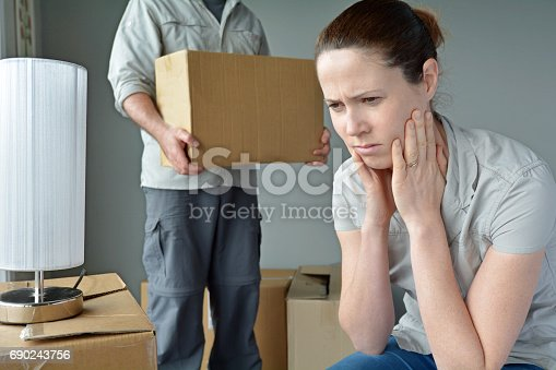 istock Upset woman when her partner is move out from home 690243756