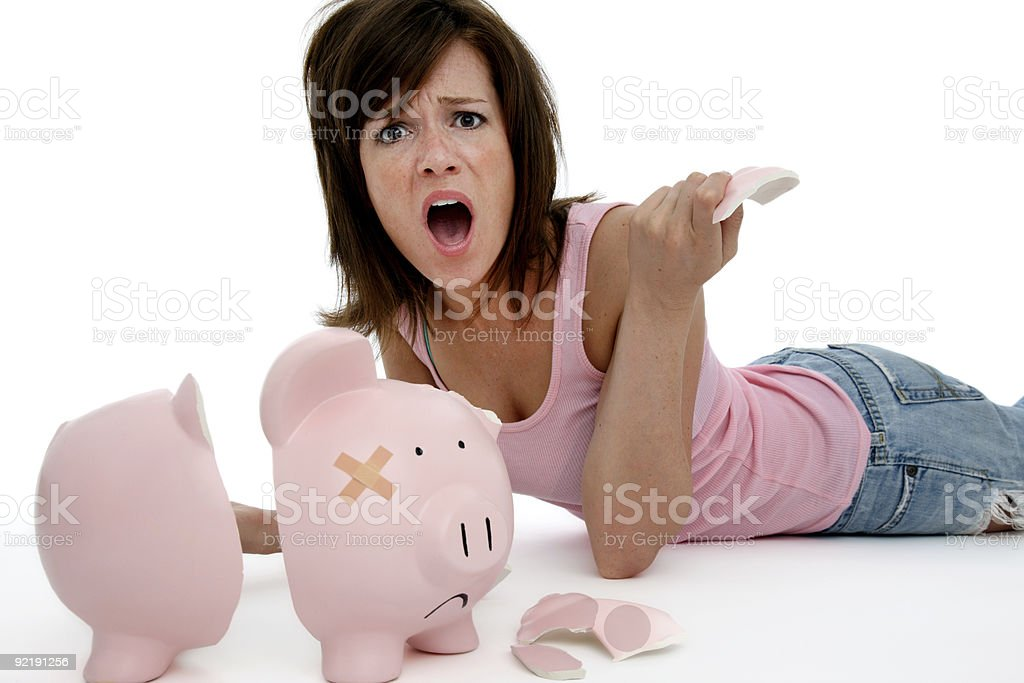 Upset woman with broken bank stock photo