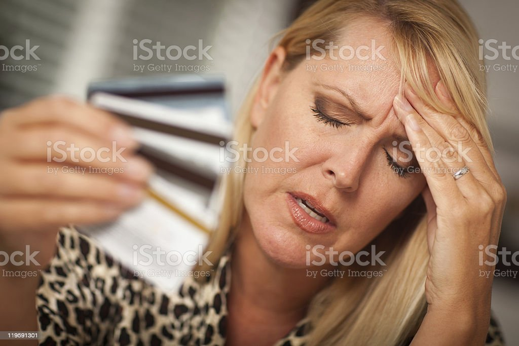Upset woman with credit cards stock photo