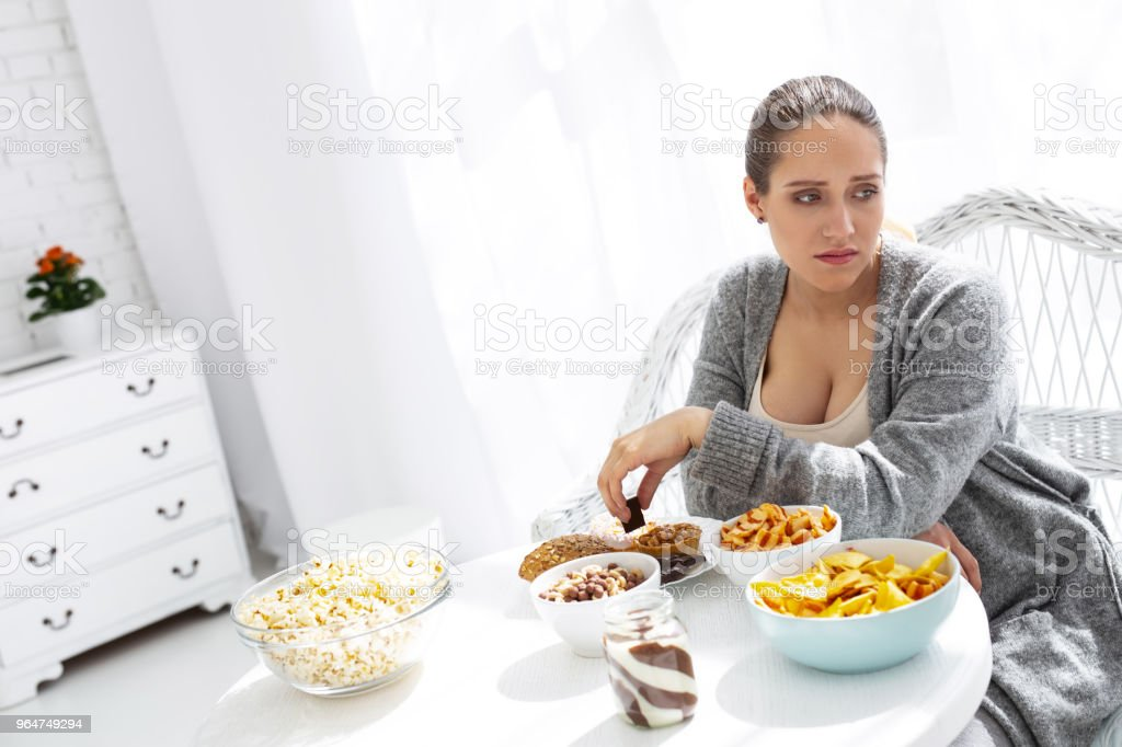 Upset worried woman wanting other food royalty-free stock photo