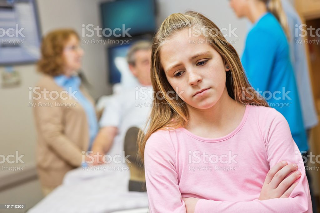 Upset young child in hospital room with sick grandparent royalty-free stock photo