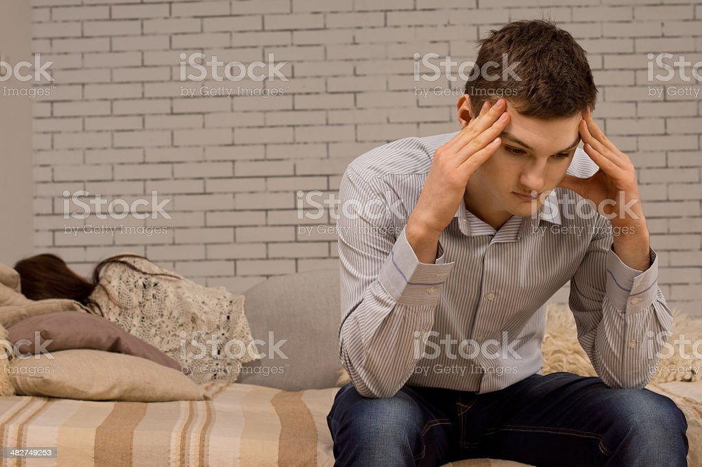 Upset young man after an argument stock photo