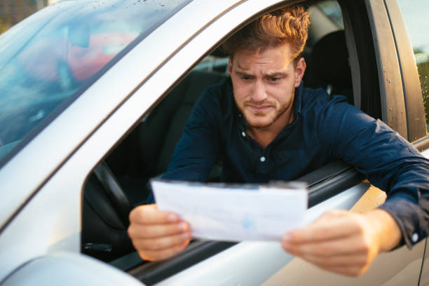 Upset young man gets parking ticket stock photo