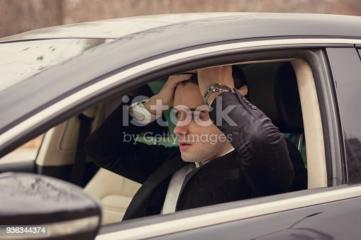 1047083324 istock photo Upset young man had a car accident 936344374
