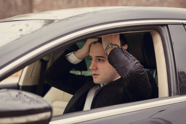 upset young man had a car accident - impaired driving stock photos and pictures