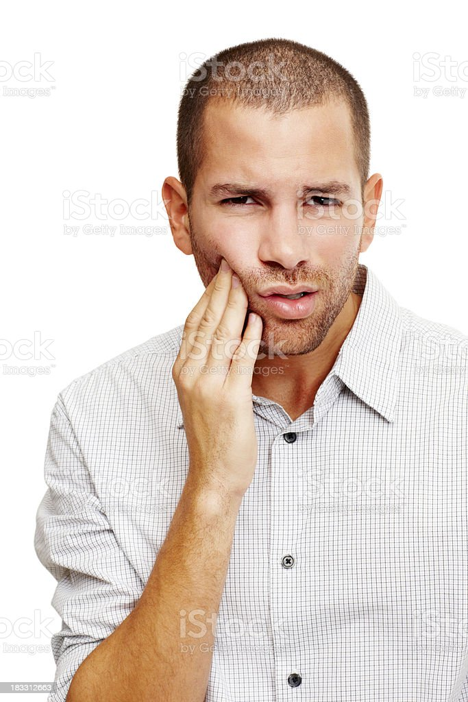 Upset young man with a toothache royalty-free stock photo