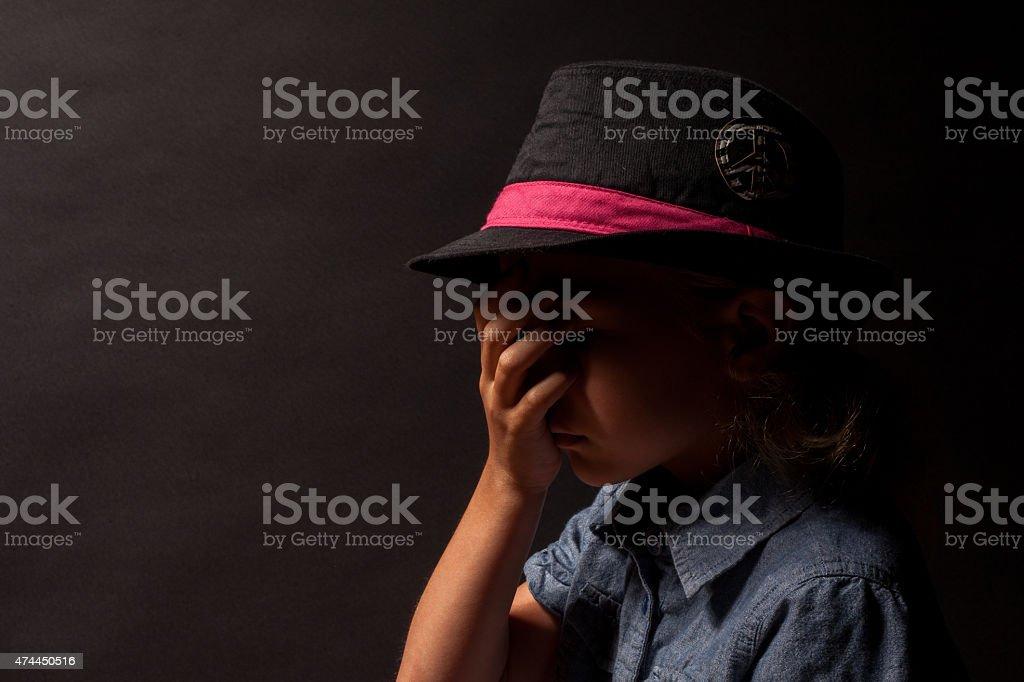 Upset Young Sad Girl on Black Background stock photo