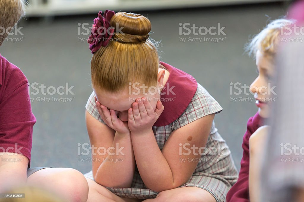 Upset Young School Girl stock photo