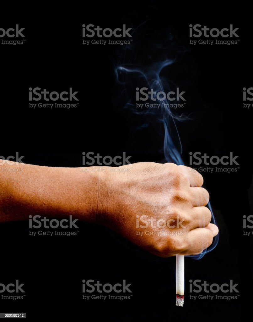 Upside down man hand holding a cigarette stock photo