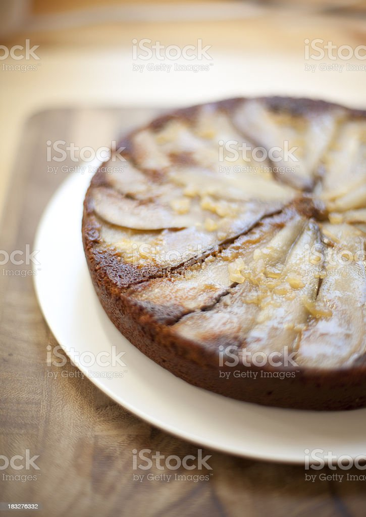 Upside down pear and ginger cake stock photo