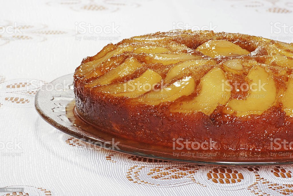upside down pear cake on glass plate stock photo