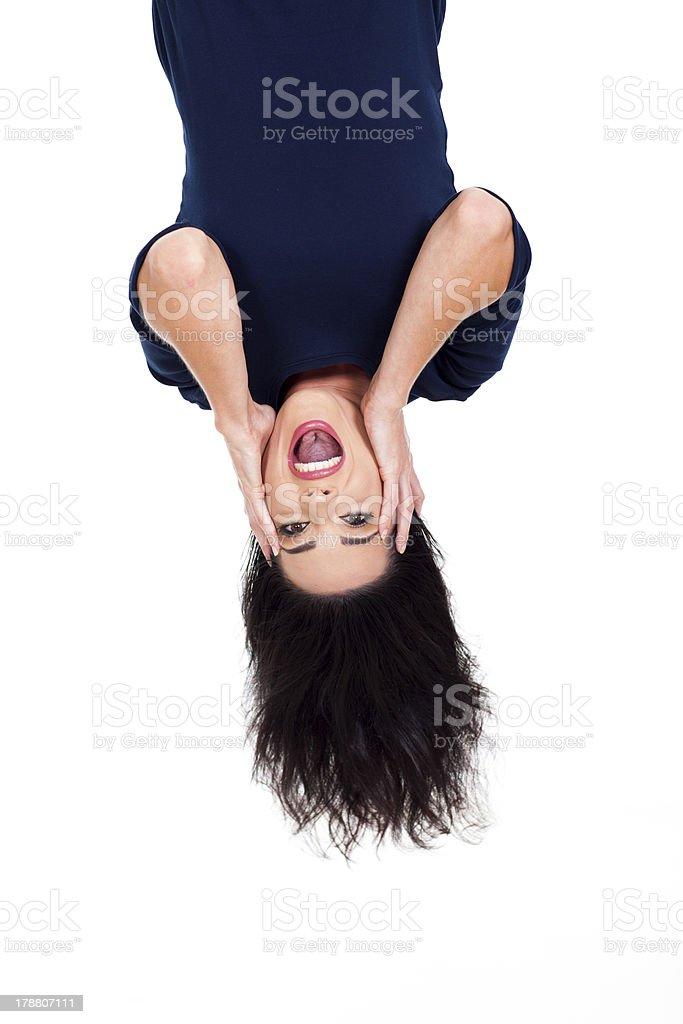 upside down photo of beautiful young woman stock photo