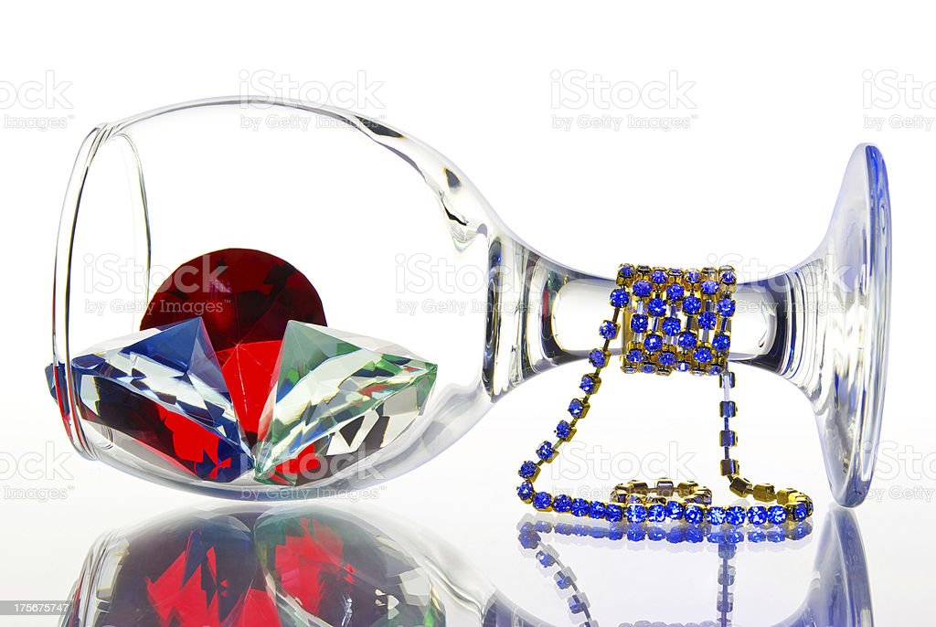 Upside down with  glass of jewels on a white background royalty-free stock photo