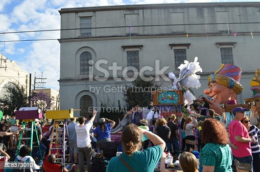 New Orleans, LA - February 8, 2015: Marching bands, dancers, and Mardi Gras floats entertain the crowds during Carnival Season.  People gather on each side of the street to watch the elaborately decorated floats and costumed marchers in the parades.  Each Mardi Gras float is decorated to a theme for the parade.