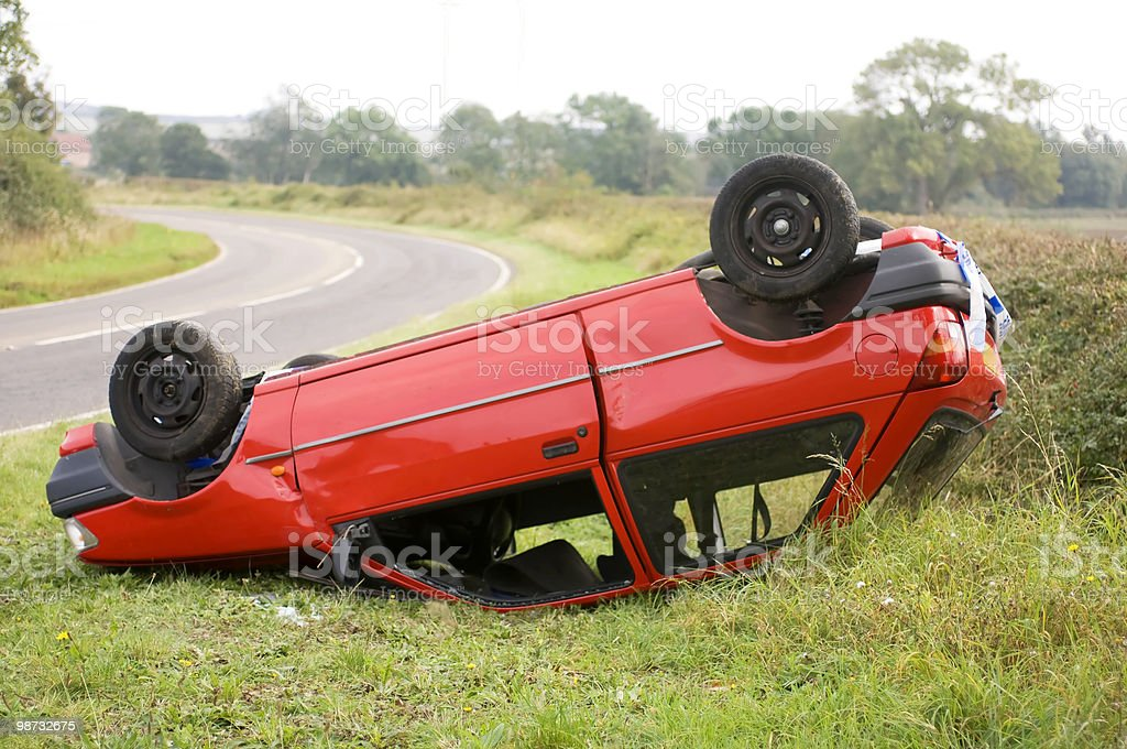 Upturned car on the side of the road royalty-free stock photo