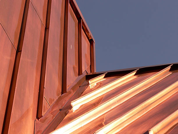 upward photograph of a copper roof - copper stock photos and pictures