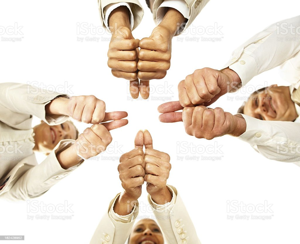 Upward view of business people showing thumbs up royalty-free stock photo