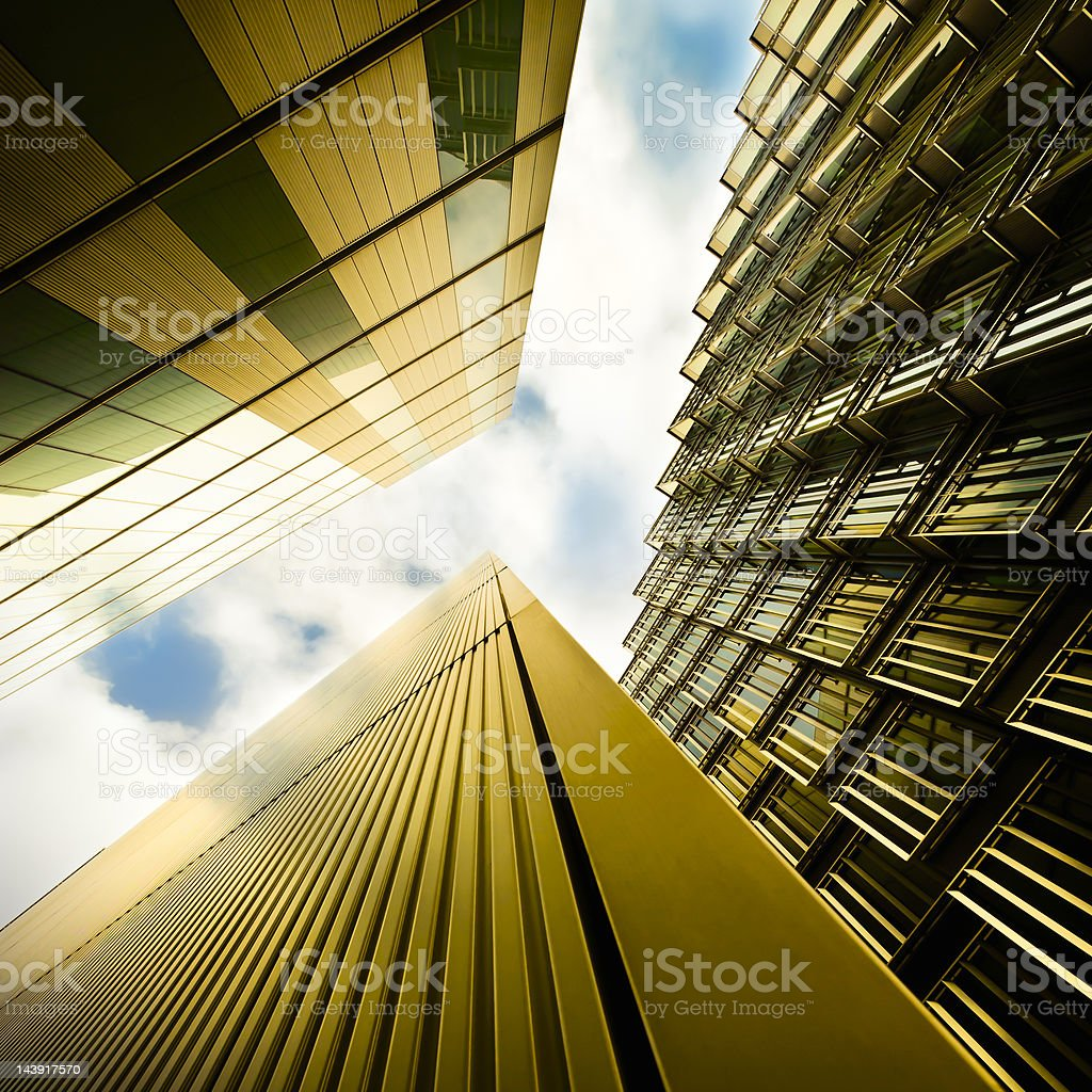 Upward view of futuristic financial buildings and the sky royalty-free stock photo