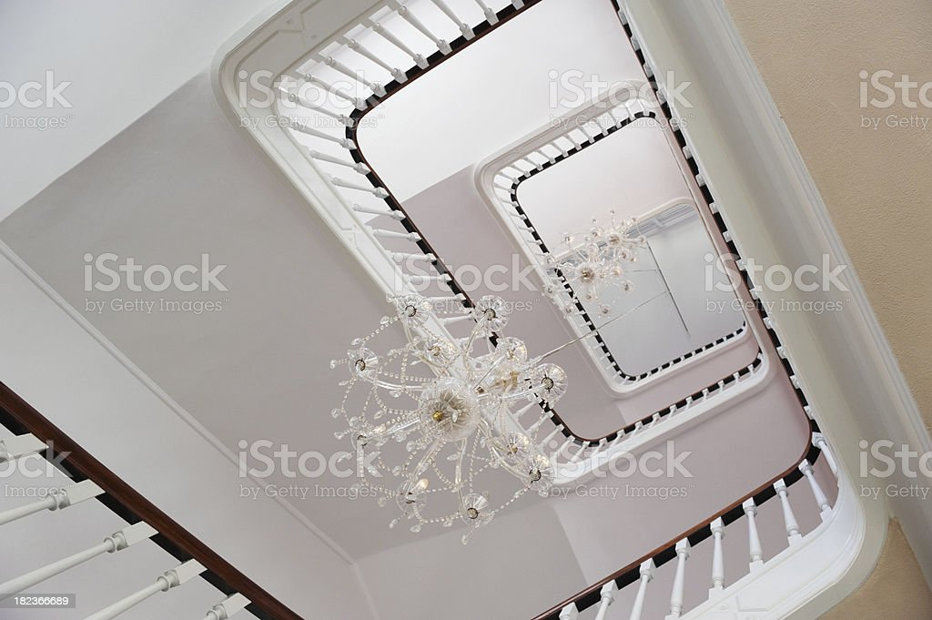 Upward view of stairwell with chandeliers in the between royalty-free stock photo