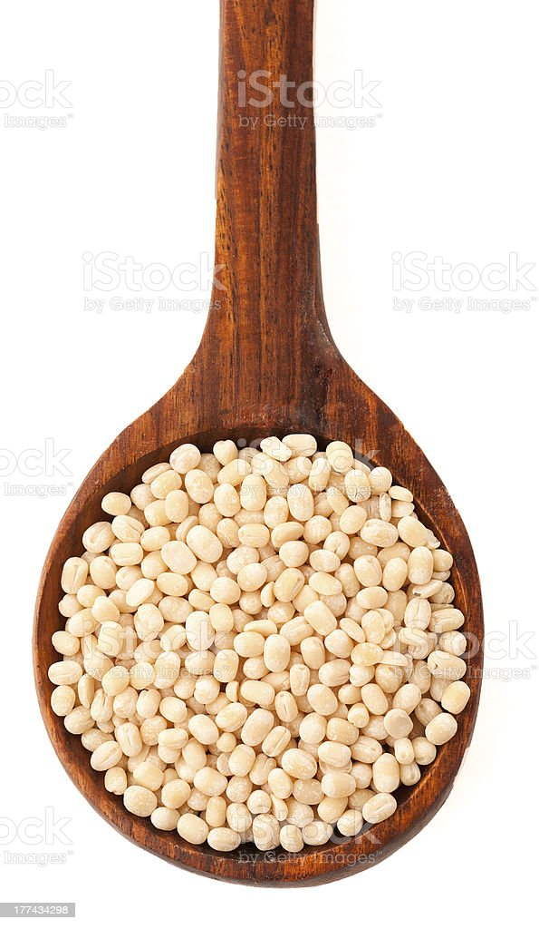 Urad dal (cereals) in the wood spoon over white stock photo