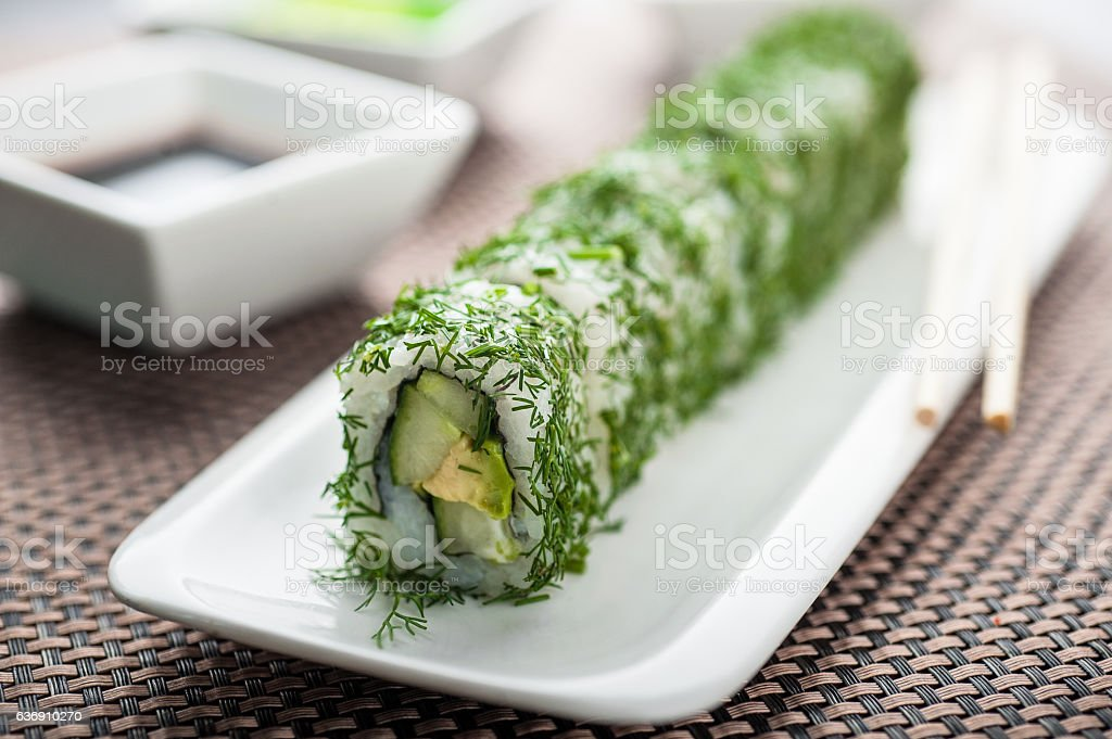 Uramaki sushi vegi green maki on a dish stock photo