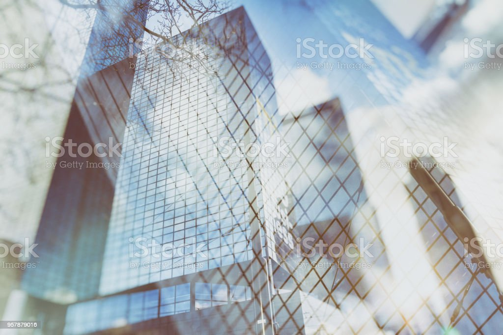 Urban abstract background of glass skyscrapers with reflected sky in the windows stock photo